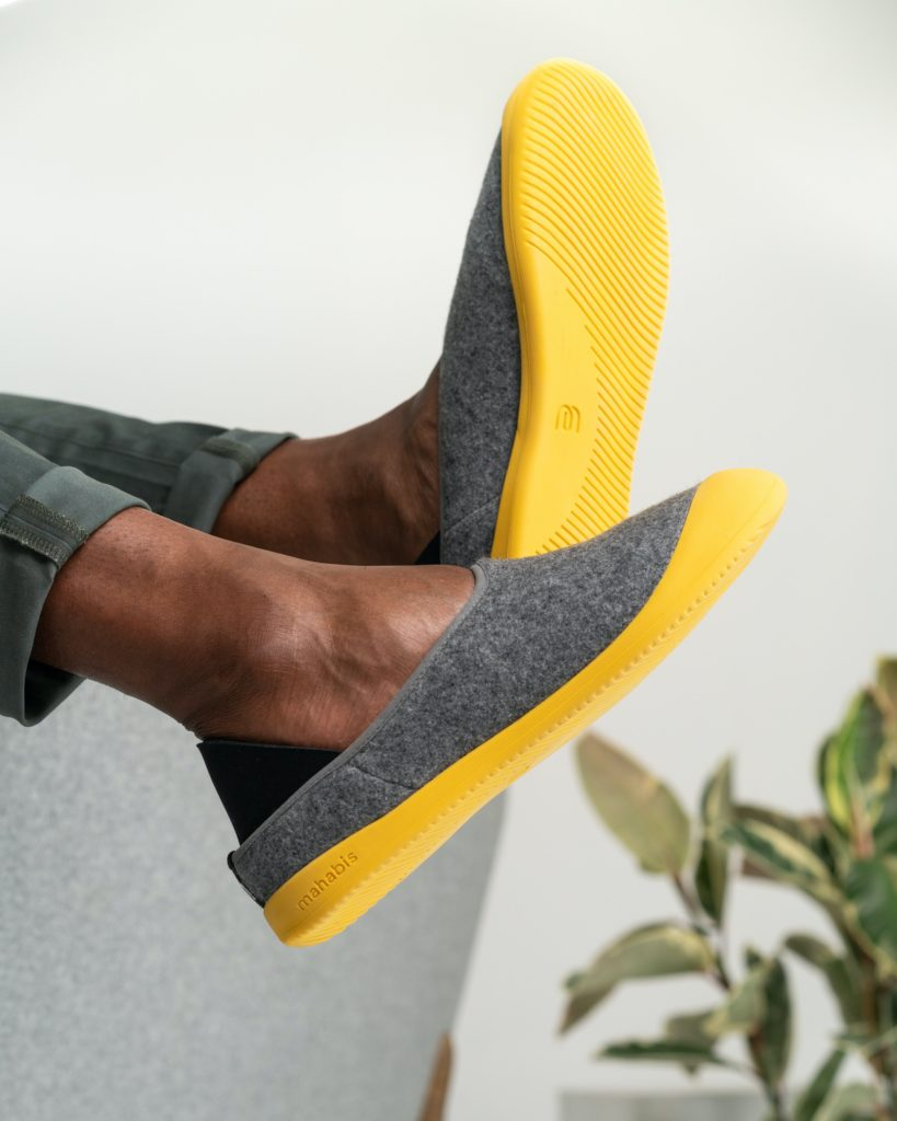 person wearing yellow and black slip on shoes